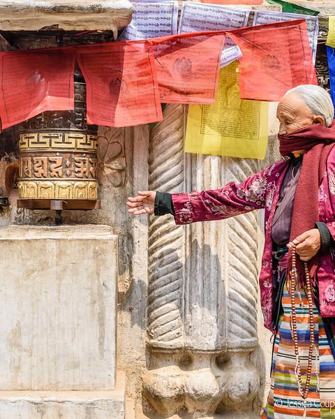 Woman at the Prayer Wheel