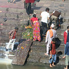 When very close to death Hindus are laid out on the stone slab with their feet in the Bagmati and given a last drink of the holy river water (which judging from its filth probably finishes them off).