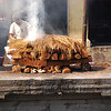 The body is then laid on a funeral pyre for cremation.