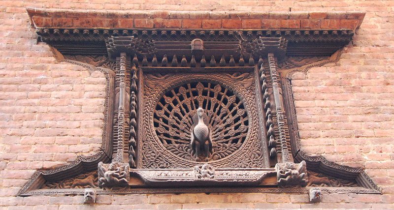 "The center section of Bhaktapur is very well preserved and maintained.  This is the famous carved wooden ""peacock"" window in one of the buildings.  It was carved in the early 14th century."