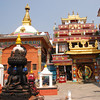 "There is a small temple square every few blocks in the old section of Kathmandu.  They often contain both Buddhist and Hindu shrines.  Here you see a Hindu statue in the left foreground and a Buddhist temple in the background.  Hindus and Buddhists often worship at each other's temples.  One Nepali told me, ""It wasn't until Christian missionaries came than anyone said you can have only one religion."""
