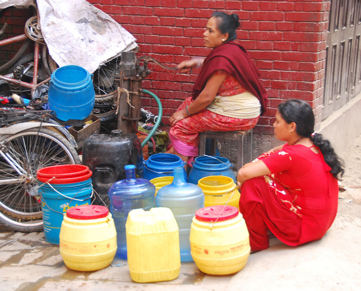 Even in Kathmandu some people still must get their water from hand-pumped communal wells located in neighborhood plazas.  Water in Nepal is never safe to drink, so we purified all of our water first by boiling and then by adding chlorine dioxide tables.