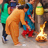 This woman is purifying herself with fire at a Hindu street temple a few blocks from my hotel.