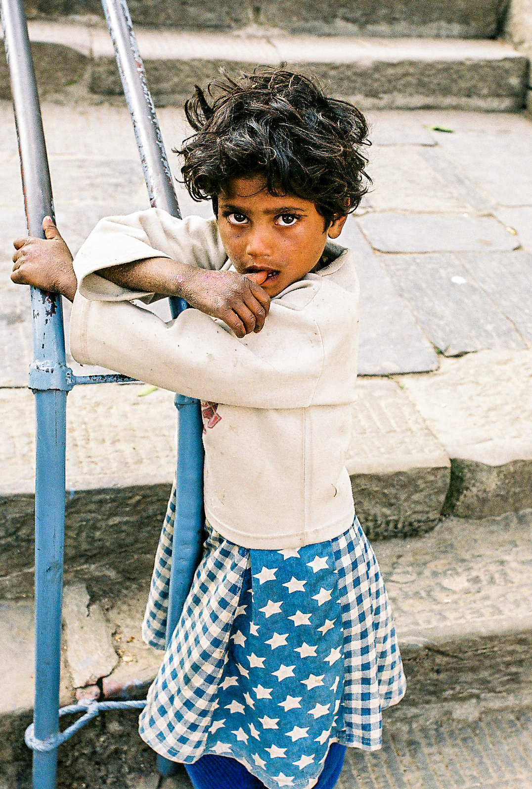 Child beggar leading up to Swayambhunath
