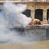 Pashupatinath is very near the Kathmandu airport.  As soon as you get off of your plane, you'll notice the smoky air and strange smell.  This is what you're smelling.
