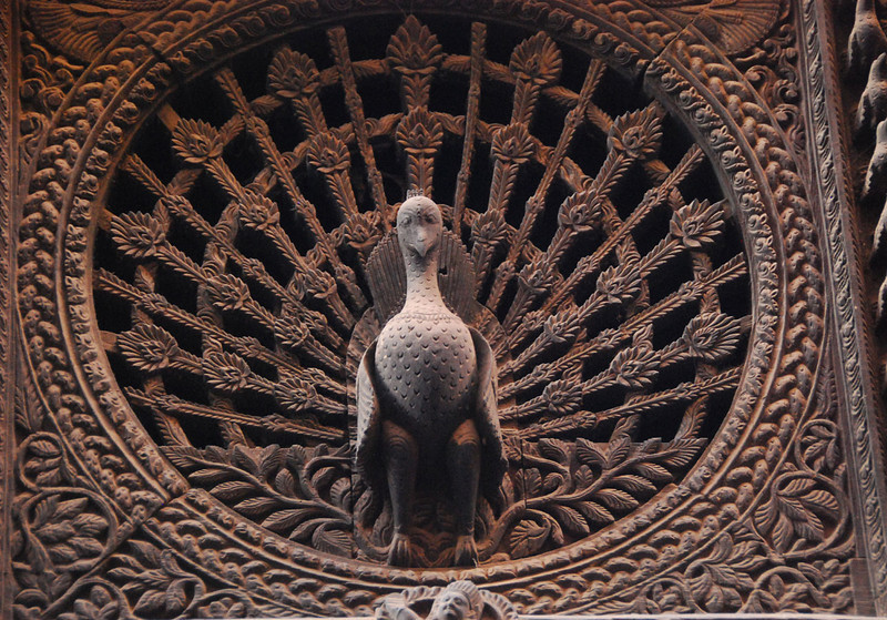 """Closeup of the peacock window.  This carving is sometimes called """"The Mona Lisa of Nepal."""""""