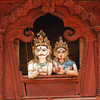 Lord Shiva and his wife Parvati peer down from their window in a Hindu temple at Kathmandu Durbar Square.