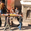 Pashupatinath is the most holy Hindu temple in Nepal and one of the most sacred abodes of Shiva in the world.  It is the location of dozens of cremations a day.  Hindu religious rituals are generally public, and cremation is no different.  Here you see a body being carried by the family to the side of the Bagmati River.