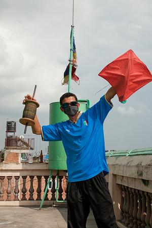 Preparing for rooftop kite battle in Kathmandu, Nepal