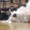 After the body is consumed, the ashes are swept into the river, eventually to reach the Ganges in India.  Bodies are cremated within a few hours of death.
