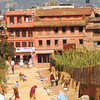 This street in Bhaktapur was being used to dry rice.  Note the high mountains not far to the north of the Kathmandu valley.
