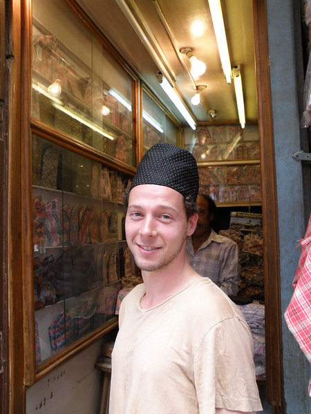 Joe trying on a hat