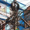 If you wonder why the electricity goes off frequently, this may be part of the reason.  When the lights go out, it's probably easier to string a new wire than to find the short.  As far as I can tell, Nepal has no building codes or safety regulations at all, and construction certainly isn't inspected by OSHA.