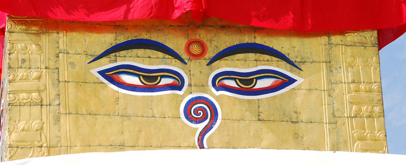 """The all-seeing eyes of Buddha are found on the four sides of large stupas.  The """"nose"""" is not a nose, but the Nepali symbol of unity."""