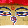 "The all-seeing eyes of Buddha are found on the four sides of large stupas.  The ""nose"" is not a nose, but the Nepali symbol of unity."