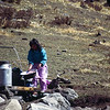 861023, day 8. Rest day at Kyangjin gompa<br /> Temba abd I visited the Lama just outside Kyangjin. Jyoti is washing clothes.