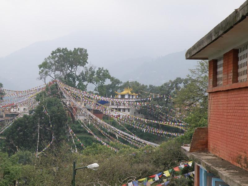 Prayer flags towards the monastery