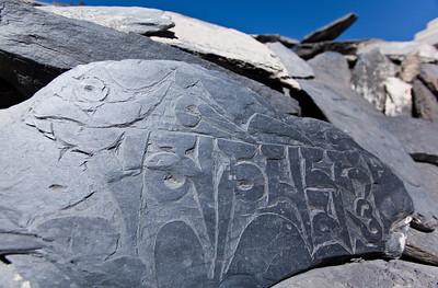 Sanskrit carved stones at base of a chorten—Marpha, Nepal