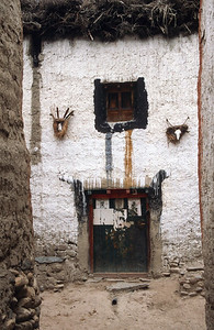 Goat heads above doorway, Lo Manthang