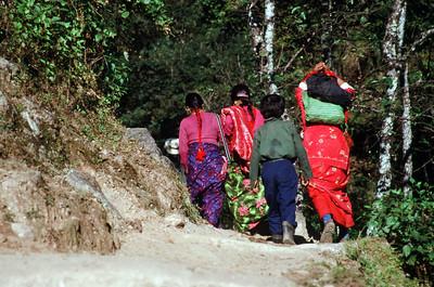 Kenja (5,380 ft).  Local women on trail.