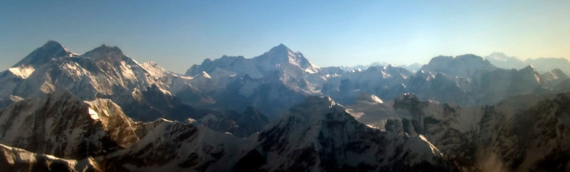 Everest (left), Lhotse, Makalu, Chamlang and Kangchenjunga (right, faint on sky line), from the west, December 2007.  This shot shows four of the five highest mountains in the world: Everest #1, 8848m; Lhotse #4, 8516m; Makalu #5, 8463m; and Kangchenjunga #3, 8586m.  All are in Nepal except Kangchenjuna, far to the east in Sikkim, India.  The second highest peak is K2, 8760m, far to the west in the Karakoram in Pakistan.