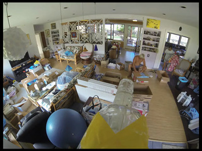 Packing the 35 supply boxes on Sunday, August 25, 2013. Kevin Auger, Dayna Minatodani, and Reid Sakamoto at the Wong's house.  time lapse