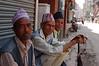 Nepali men in traditional Newari caps enjoying the cool morning