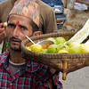 Street vendor selling cucumber with spices to people traveling to Tansen Palpa