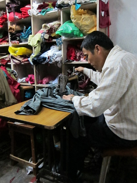 fixing my pants for 20 rupees - about 30 cents  - this was about an hour after the big earthquake: no one cared- Tansen