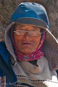 An elderly Sherpa maintains the trail to Everest Base Camp