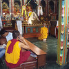a temple by Swayambhunath - note the monk talking on the cell phone