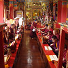 monks chanting in a temple next to Swayambhunath