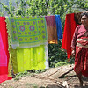 The vibrant colors of the cloth the women wear are stark contrast to the daily struggle to survive.