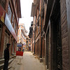 Bhaktapur town, just outside of Kathmandu. Clean and well maintained, people live amidst many temples frequented by tourists.