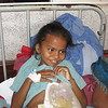 The Hirshsprung girl smiling along with her colostomy. A visiting pediatric surgeon this year will hopefully resect her diseased colon.