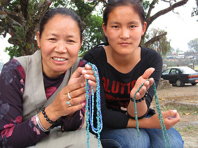 Tibetan women in Pokhara selling jewelry. They cannot become Nepal citizens and are confined to refugee camps scattered around the city.