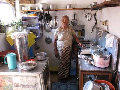 Beena's mother in their kitchen.