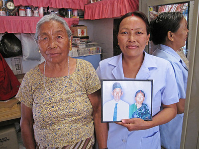 Beena, her mom and a picture of her dad and mom.
