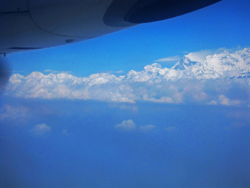 A much enhanced photo of the Himalayas, flying into Pokhara. The actual haze made a good view of the mountains impossible.