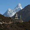 Ama Dablam and the monument to Tensing Norgay - notice the porter walking along the track.