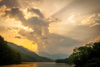 Sunrays peeking through clouds, Pokhara | Nepal