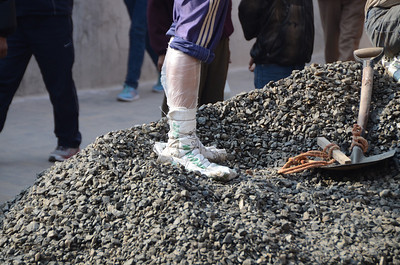This is what this man used as shoes while shoveling huge piles of stone.  Kathmandu, Nepal.