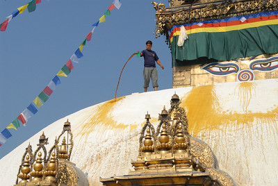 Blessing Swayumbhunath (aka Monkey Temple) in Kathmandu, Nepal with colored water to make the stupa look like it has lotus petals.