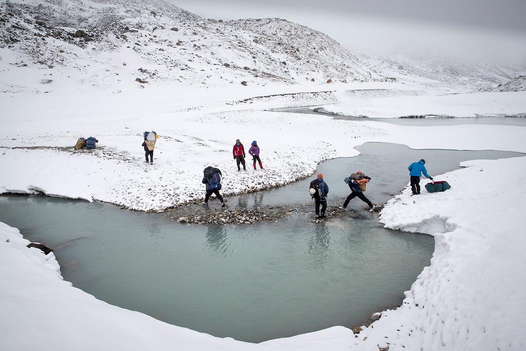 Trekkers in snow after snowstorm