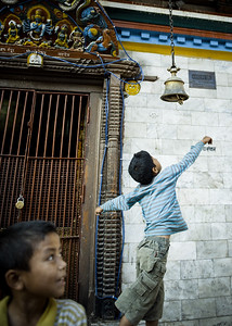 Kids ringing a bell outside a temple | Kathmandu | Nepal