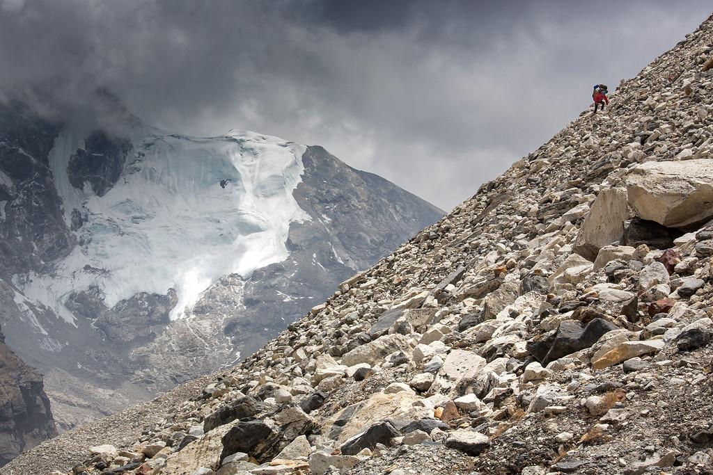 Mounteineer and porters on high altitude