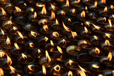 Tibetan buddhist butter (usually vegetable oil) lamps burning