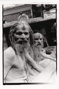 Sadhus are Hindu holy men dedicated to achieving liberation by leaving all material attachments behind. Some sadhus cover themselves with the ash of cremated bodies.