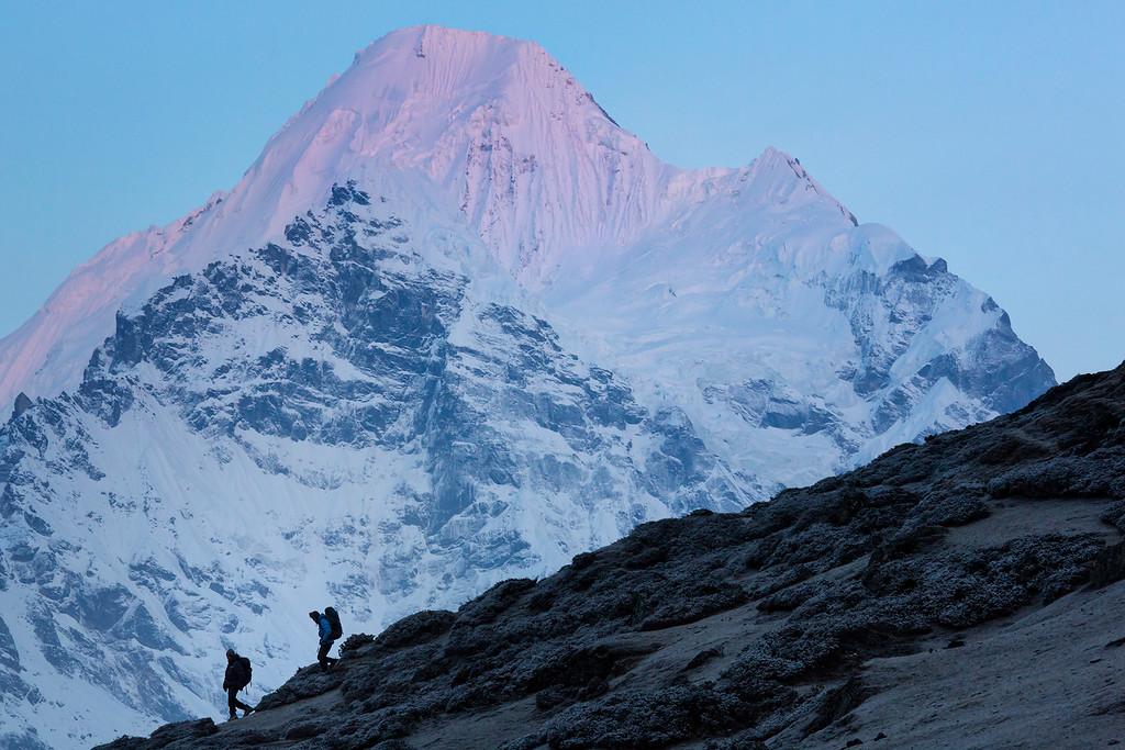 Trekkers in the early morning light