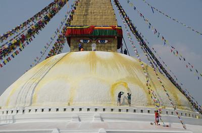 Painting new lotus petals on Boudhanath stupa in Kathmandu, Nepal.